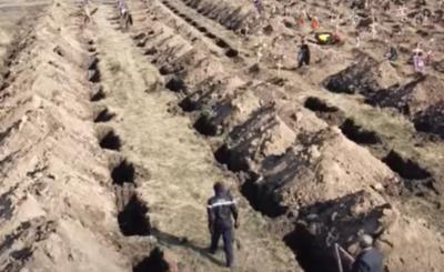 Koronawirus, Ukraina: Mer miasta Dniepr podjął szokującą decyzję, kopia masowe groby. Kilkaset otworów w ziemi uzmysławia powagę sytuacji